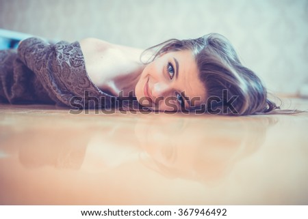 sexy seductive woman lying on the floor - stock photo