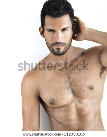 Sexy shirtless fit male model against white background - stock photo
