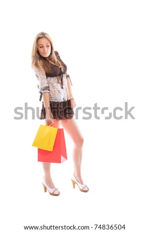 Sexy shopping girl isolated over white background - stock photo