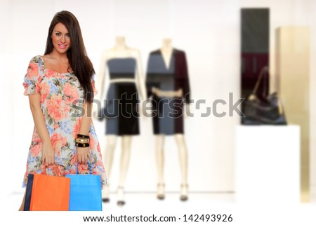 Sexy shopping woman holding bags