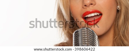 sexy singer lips with retro microphone on white - stock photo