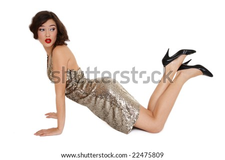 Sexy slim girl in golden dress posing on white background