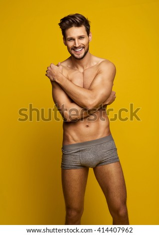 Sexy Smiling Male Model - stock photo