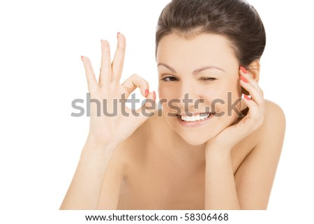 Sexy smiling woman showing OK and provocative winking - stock photo