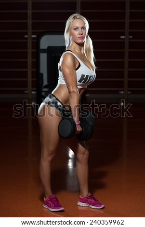 Sexy Sporty Woman In The Gym With Exercise Equipment - stock photo