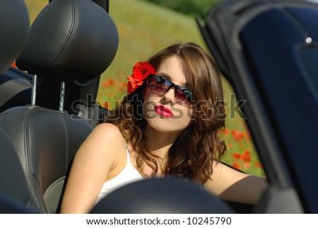 Sexy summer girl in car - stock photo