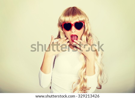 Sexy surprised beautiful blonde woman in sunglasses. - stock photo