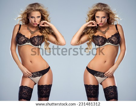 Sexy two woman posing in studio, wearing sensual lingerie. Girl looking at camera. Perfect slim body. - stock photo