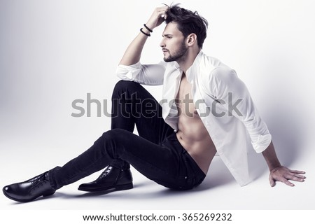 Sexy undressed model in black jeans and shoes - stock photo