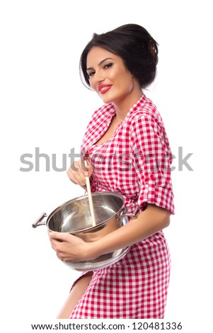 Sexy wife cooking - Pinup style housewife cooking - stock photo