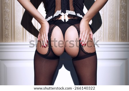 Sexy woman ass in black underwear at vintage wall - stock photo