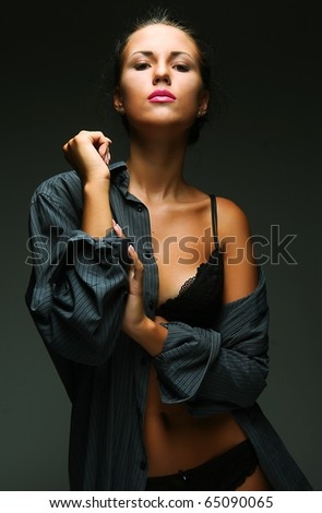 Sexy woman. Black lingerie and black and stockings - stock photo