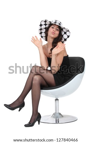 Sexy woman blowing kisses - stock photo