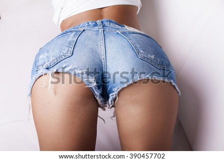 Sexy woman body in jeans shorts. .Great ass.  - stock photo
