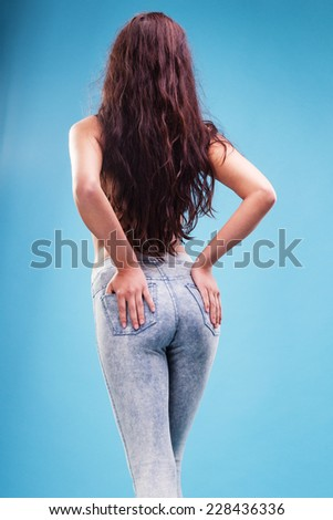 Sexy woman buttocks in jeans on the blue background  - stock photo