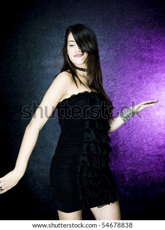 Sexy woman dancing on a colored background