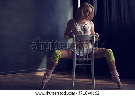 Sexy woman dancing on the chair - stock photo