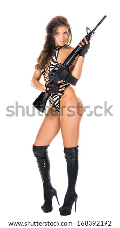 sexy woman dressed in a striped swimsuit high boots with a gun isolated on white - stock photo