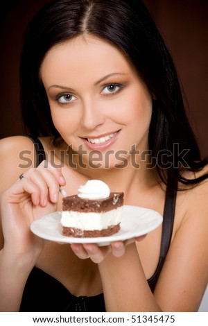 Sexy woman eating chocolate cake - stock photo
