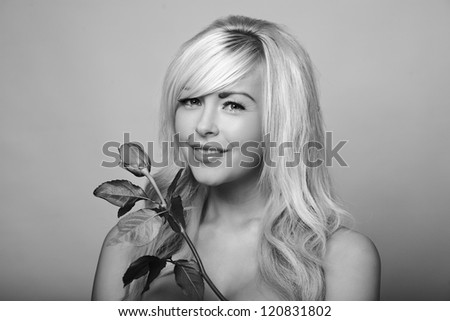sexy woman holding a single rose - stock photo