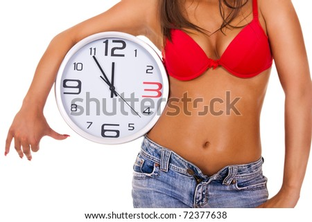 sexy woman holding big clock on white background - stock photo