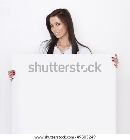 Sexy Woman holding blank billboard - stock photo