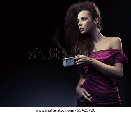 Sexy woman holding cup of tea - stock photo