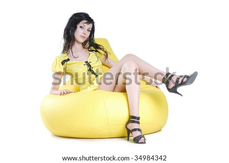 sexy woman in armchair - stock photo