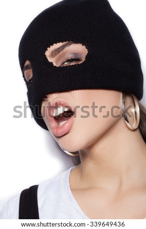 sexy woman in balaclava - crime and violence on white background not isolated - stock photo