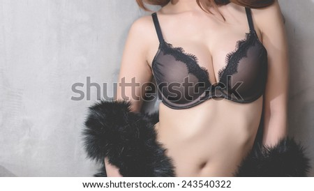 Sexy woman in black lingerie sexy at cement wall - stock photo