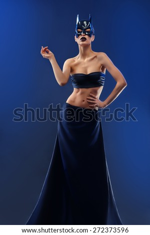 sexy woman in cat mask on a black - stock photo