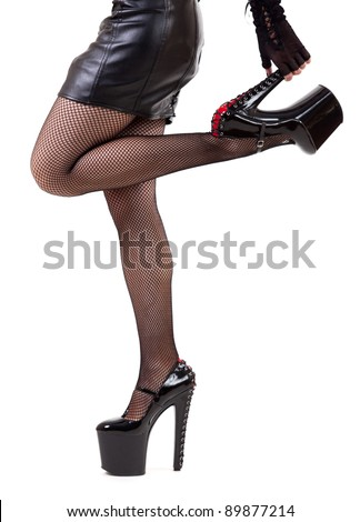 Sexy woman in extreme fetish shoes, isolated on white background - stock photo