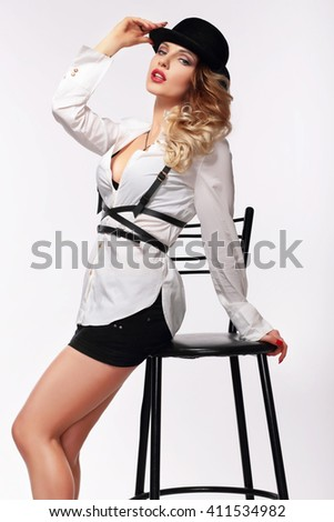 Sexy woman in hat and shirt. Gangster style. - stock photo