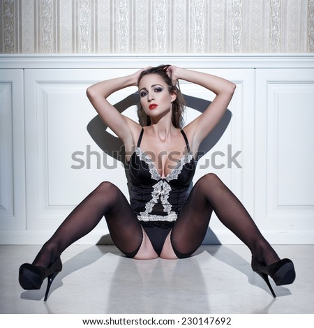 Sexy woman in lingerie sit on floor, sensuality - stock photo