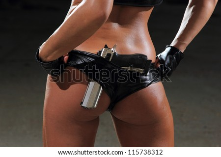 Sexy woman in lingerie  with gun - stock photo