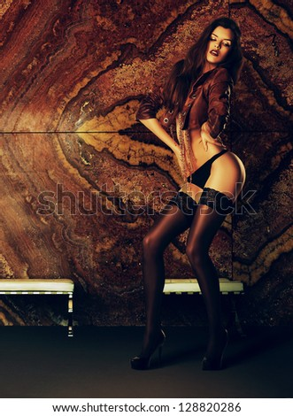 sexy woman in marble interior - stock photo