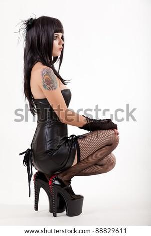 Sexy woman in mini dress, studio shot on white background - stock photo