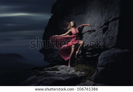 Sexy woman in mountain - stock photo