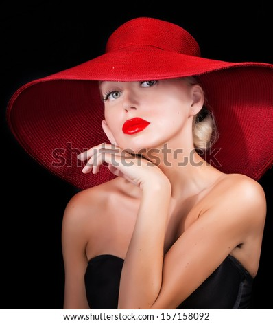 sexy woman in red hat with red lips looking at camera - stock photo