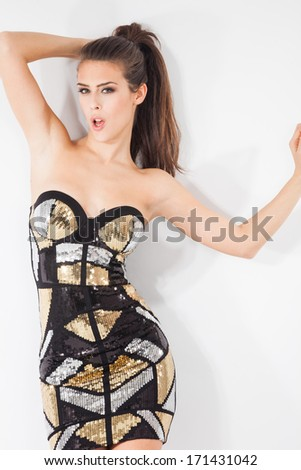 sexy woman in short dress with sequins studio shot - stock photo