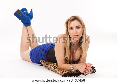 Sexy woman in studio fashion pose with leopard print pillow on a white background.