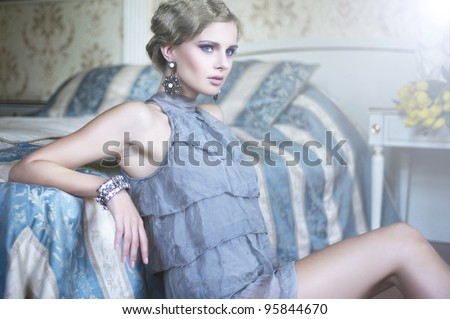 Sexy woman in the stylish room - stock photo
