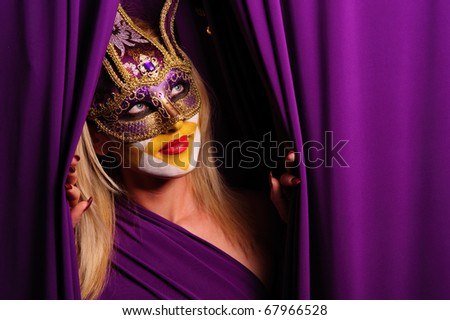 sexy woman in violet mask open curtain - stock photo