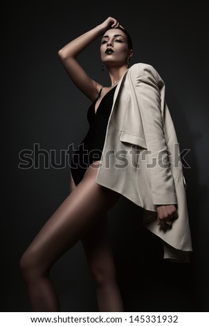 sexy woman in white blazer and black body - stock photo
