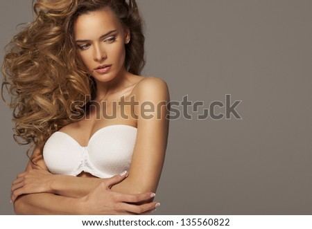 Sexy woman in white lingerie with natural make-up - stock photo