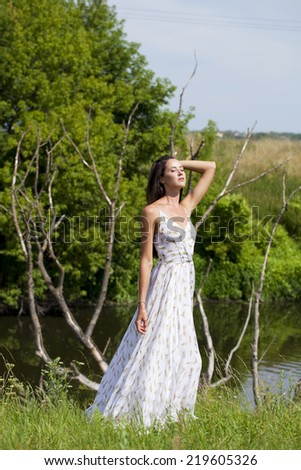 Sexy woman in white long dress  - stock photo