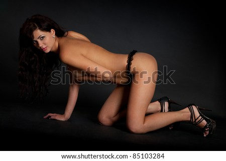Sexy woman isolated on a black background - stock photo