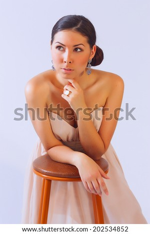 Sexy woman leaning on a chair