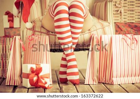 Sexy woman legs. Christmas concept - stock photo