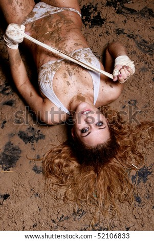 sexy woman lies on sand - stock photo